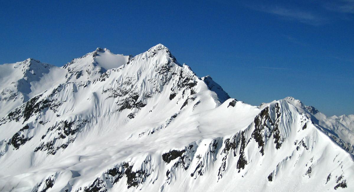 Gipfelblick vom Maroikopf auf den Stubner Albonakopf (Bildmitte) und dem Kaltenberg (Verwall)